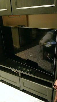 black flat screen TV with black wooden TV stand New Orleans, 70112
