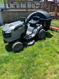Craftsman riding lawnmower including bagging and power raking equipment. Brownstown Charter Twp