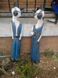 Folk art wood carving  of tall cats