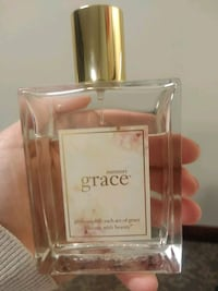 Almost new large bottle of grace summer perfume