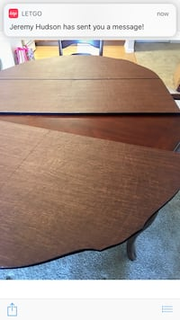 Brown wooden drop table 4 chairs  24 km