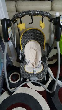 baby's gray white black and yellow portable swing