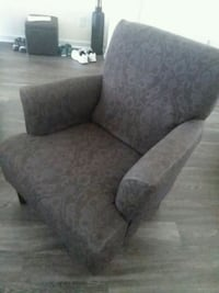 gray fabric sofa chair with throw pillow Fort Myers