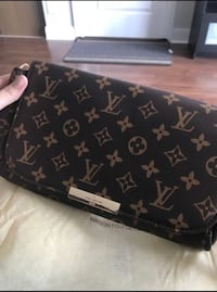 black and brown Louis Vuitton leather wristlet Mississauga, L4Z 0B8