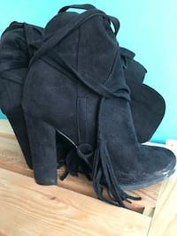 pair of women's black suede chunky heel booties