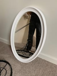 White framed oval mirror