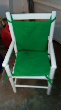 green and white wooden armchair