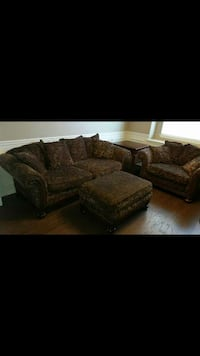 beige and black floral 2-seat sofa and sofa chair