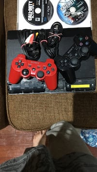 Black sony ps3 super slim console with two controllers and call of duty black ops two. PS3 good condition but damages a little Markham, L3S 3Y9