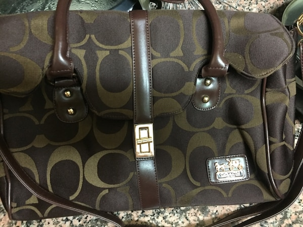 dc85ade5 Women's brown and black Coach hand bag
