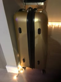 Gold rolling suitcase