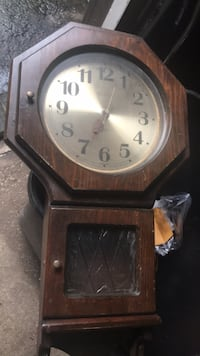 """hanging wall Clock 14""""x24"""". battery operated Northport, 11768"""