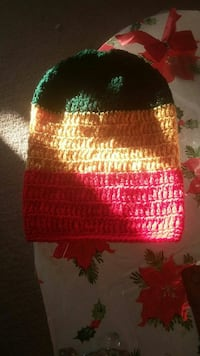 green, yellow, and red knitted cap