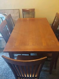 rectangular brown wooden table with four chairs dining set San Antonio, 78232
