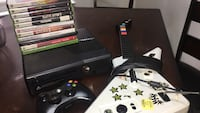 black Xbox 360 console with controller and game cases Pueblo, 81001