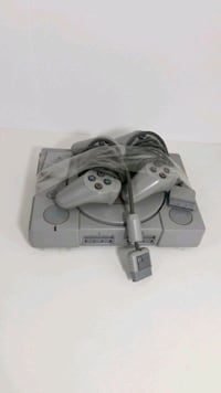 SONY  Playstation 1 with 2 controllers  and memory card.