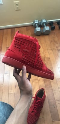 Pair of red high top sneakers Baltimore, 21217