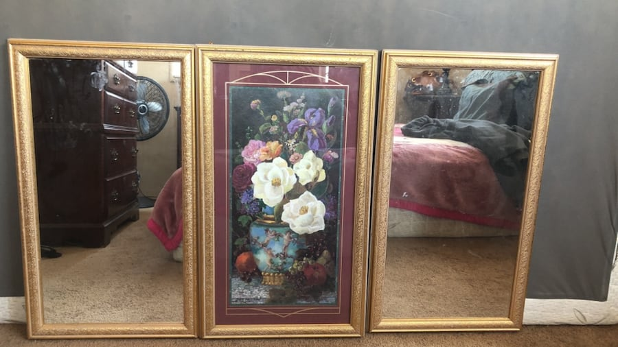 Rectangular mirror with brown wooden frame from home interior come all together 1 flower in the middle and two mirrors on each side  1740a1b1-b98e-464c-9b3a-a0654618be3a