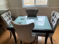 rectangular brown wooden table with four chairs dining set. Poolesville, 20837