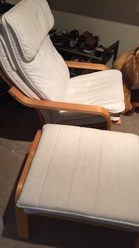 brown wooden frame white padded glider chair