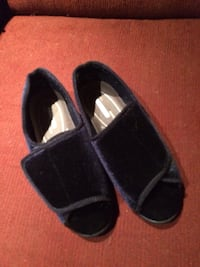 LOCATED IN BEWDLEY pair of blue slippers