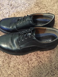 Pair of black leather dress shoes