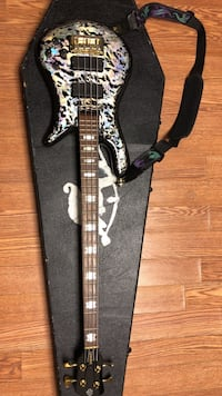 White and black electric guitar with case