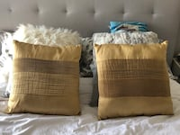 2 gold colour decorative pillows. $5 each in excellent condition  Burnaby, V3N 0G5