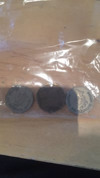 two round silver and gold coins null, T0L 1W4