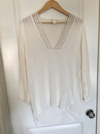 White v-neck long-sleeved shirt Edmonton, T6M 2X1