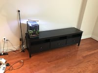 black wooden TV stand with flat screen television Washington, 20037