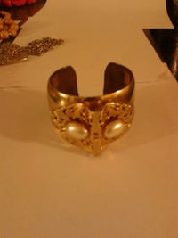 gold-colored white gemstone cuff bracelet