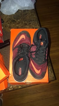pair of red Nike basketball shoes Houston, 77080