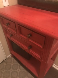 red wooden 3-drawer chest