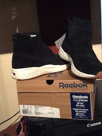 pair of black Reebok Classic mid-rise sneakers with box