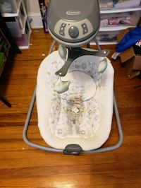 baby's white and Graco swing chair Baltimore, 21214