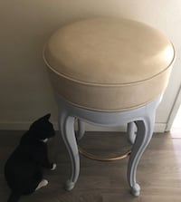 4 Barstools , newly painted, beige leather swivel seats, solid Oak.