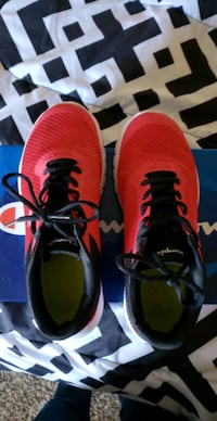 Pair of red-and-black Champion running shoes Abilene, 79606