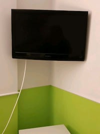 Wall mounted Colour TV with remote