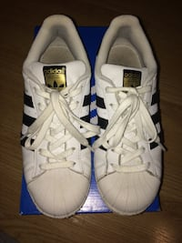 pair of white adidas superstar shoes with box  Chambly, J3L 5P2