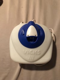white and blue Vicks humidifier 193 mi