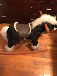 Rocking horse it makes a horse sound when you push its ear and gallops. Great for a little kid that loves horses!! Come on and let's find this guy a new home.