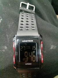 black and red digital watch