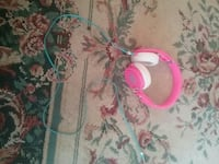 white and pink corded headphone