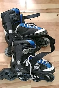 pair of black-and-blue inline skates Guelph, N1K 1P8