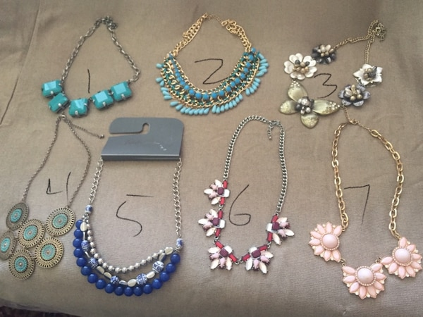 three assorted beaded necklaces and two bracelets