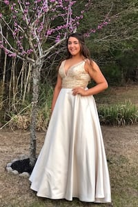"""Women's champagne/gold prom or wedding dress - Morilee by Madeline Gardner. Size 14, girl pictured is 5' 8"""" with heels - no alterations to the length. Asking $250.00 OBO - runs smaller than 14, my daughter was a size 12 and medium when she wore this   Myrtle Beach, 29579"""