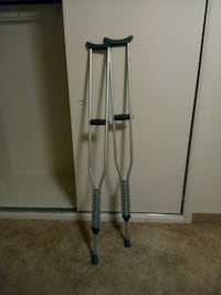 pair of grey axilliary crutches