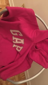 pink and white Gap pull-up hoodie