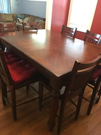 **moving sale** brown wooden 9-piece dinette